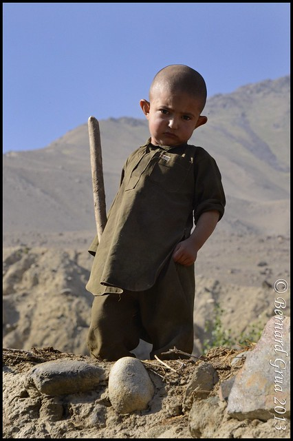 Young Wakhi boy on a roof in Khandut, Afghan Wakhan © Bernard Grua