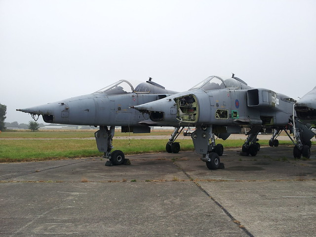 Jaguar GR-3A XZ396/EQ (Left) and XZ366/FC ex RAF. Stored (Minus wings and tails) Bentwaters, 21-07-2013.