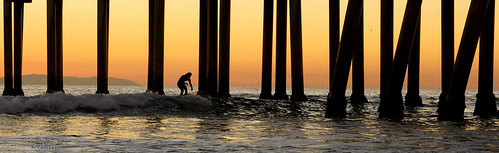 ocean california ca travel sunset fall beach water lines vertical danger pier glow pacific dusk surfer wave surfing calif repetition pilings southerncalifornia huntingtonbeach 2013 hhsc2000