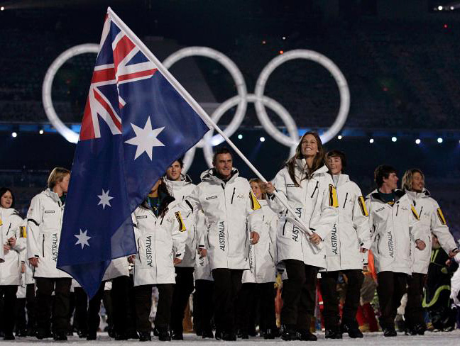 Aussie flag bearer Torah Bright leads out the Australian team