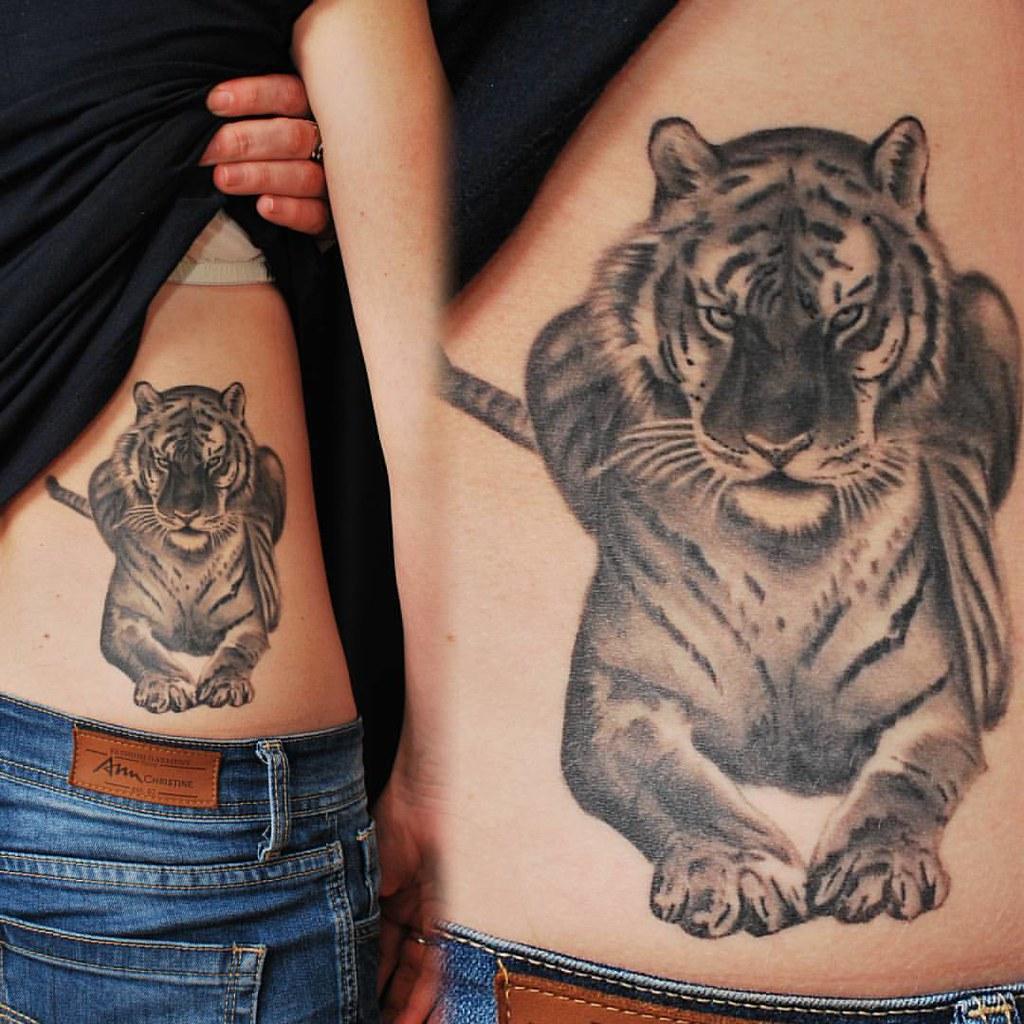 50e7b96d65b45 ... Black and gray realistic tiger tattoo on girls side. Artist  @martins.silins #