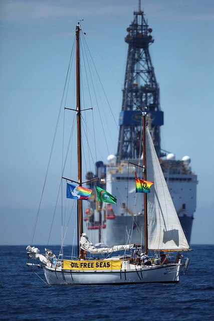 The sailing vessel Vega stands her ground as the drill ship the Noble Bob Douglas enters the drilling area.