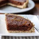 Vegan Cocoa & Marmalade Tart⠀ Crispy cookie on the outside with a rich cocoa filling. The marmalade topping goes well with cocoa. A great dessert to have with afternoon coffee.⠀ .⠀ ココアとマーマレードのタルト⠀ 周りはさくさくクッキー、中は濃厚なココア生地。相性の良いマーマーレードをトッピングしました。コーヒーのお供にぴったり