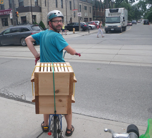 Bringing new hive boxes on the back of my bike | by Shawn Caza