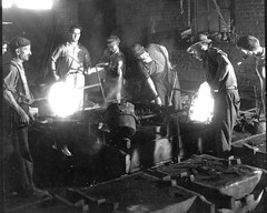 06. Pat O'Neil with foundrymen pouring molds at 17th and Hull Foundry.  1930 to 1940?