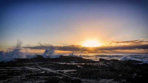 sunsetsandsunrisesgold sky sunrise sea sun water weather rocks goldcoast cloudsstormssunsetssunrises clouds
