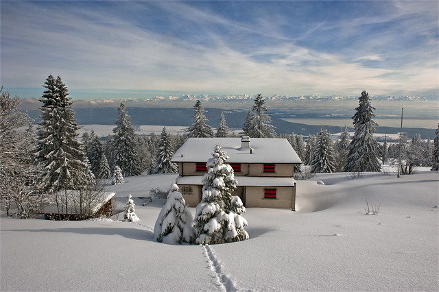 Swiss winter time , a house with a view to the Alps.  No. 3187.