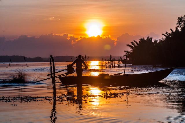morning light shining fisherman