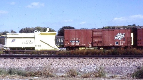 Chicago Northwestern --  former Rock Island --  snowplow and Mineapolis and St. Louis boxcar at Fremont Nebraska in 1985