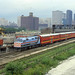 RTA F40PH #105 pulls double decker Rock Island commuter cars out of Chicago on 6/30/78 by LE_Irvin