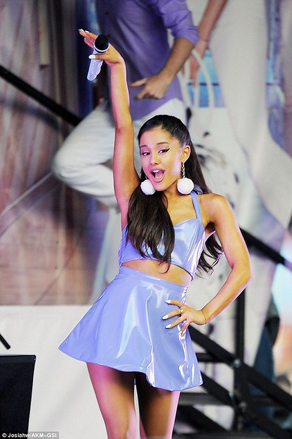 Ariana Grande in vinyl top and skirt