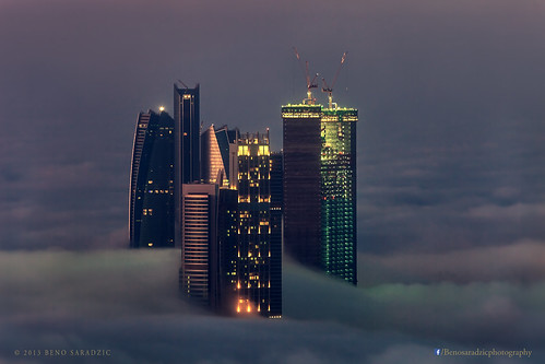 city urban mist beautiful horizontal misty fog sunrise dark dawn amazing moody cityscape skyscrapers towers uae foggy abudhabi mysterious haunting unitedarabemirates aerialphotography mystique stregis muted surprising aerialcityscape nationtowers etihadtowers adnochq