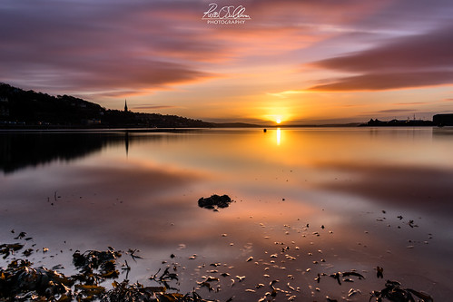 cobh cathedral sunrise clouds water sea ireland navy sun colours