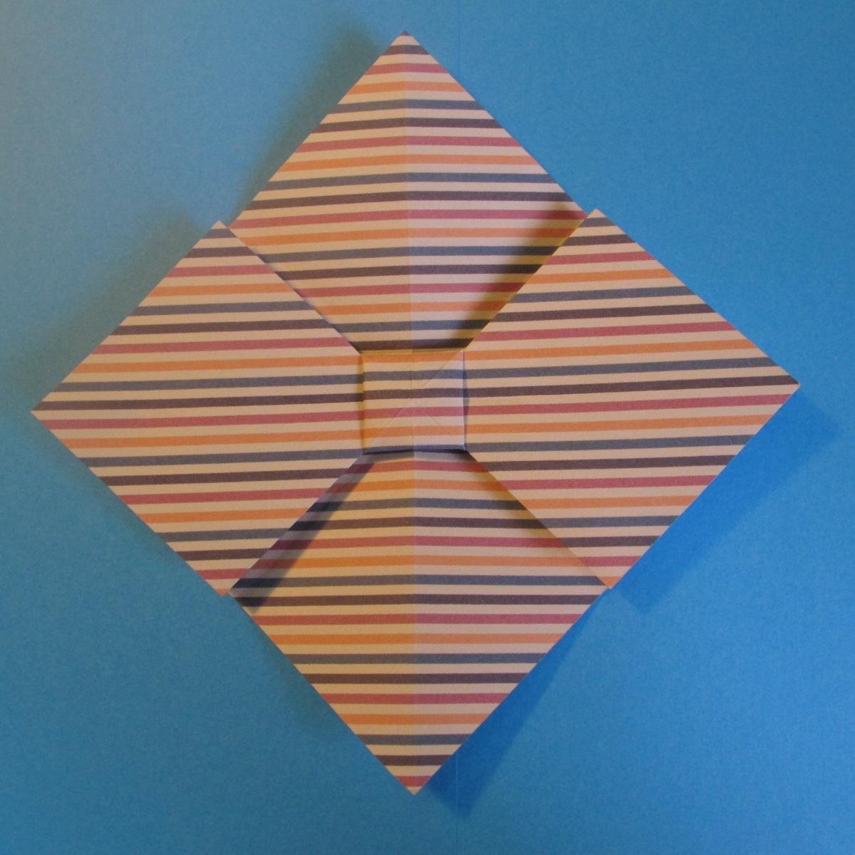 วิธีการพับกระดาษเป็นโบว์หูกระต่าย 015