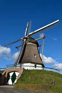 Milling Grain   by Ed van de Zilver