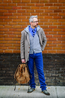A layered smart casual outfit: Striped tie \ dress shirt \ grey cardigan \ grey hoodie \ Harris tweed jacket \ jeans \ grey brogues | Silver Londoner, over 40 menswear | by silverlondoner