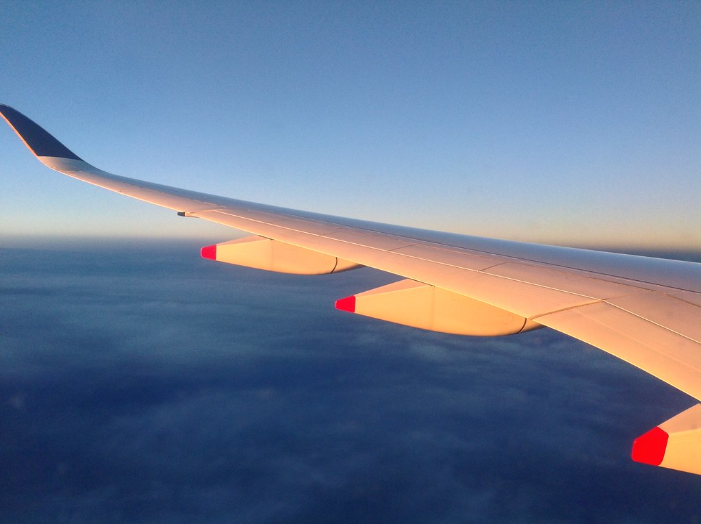 Wing of A350 of Singapore Airlines in the evening sun en r ...