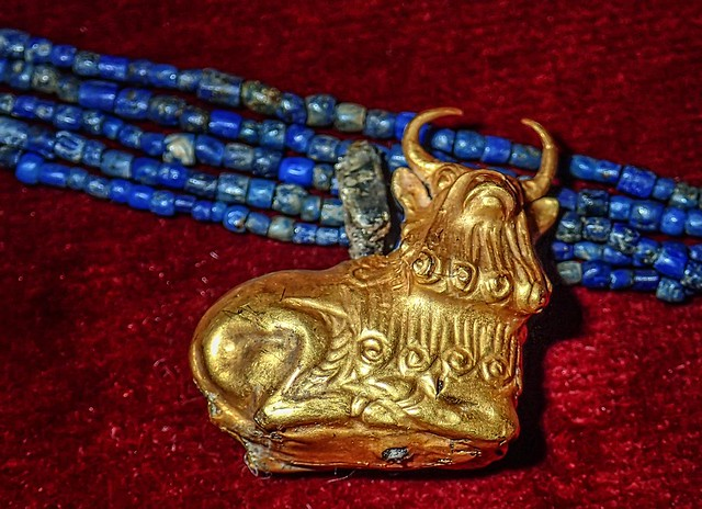 Lapis lazuli necklace with gold bull pendant recovered from the royal cemetery of Ur, Iraq 2550-2450 BCE