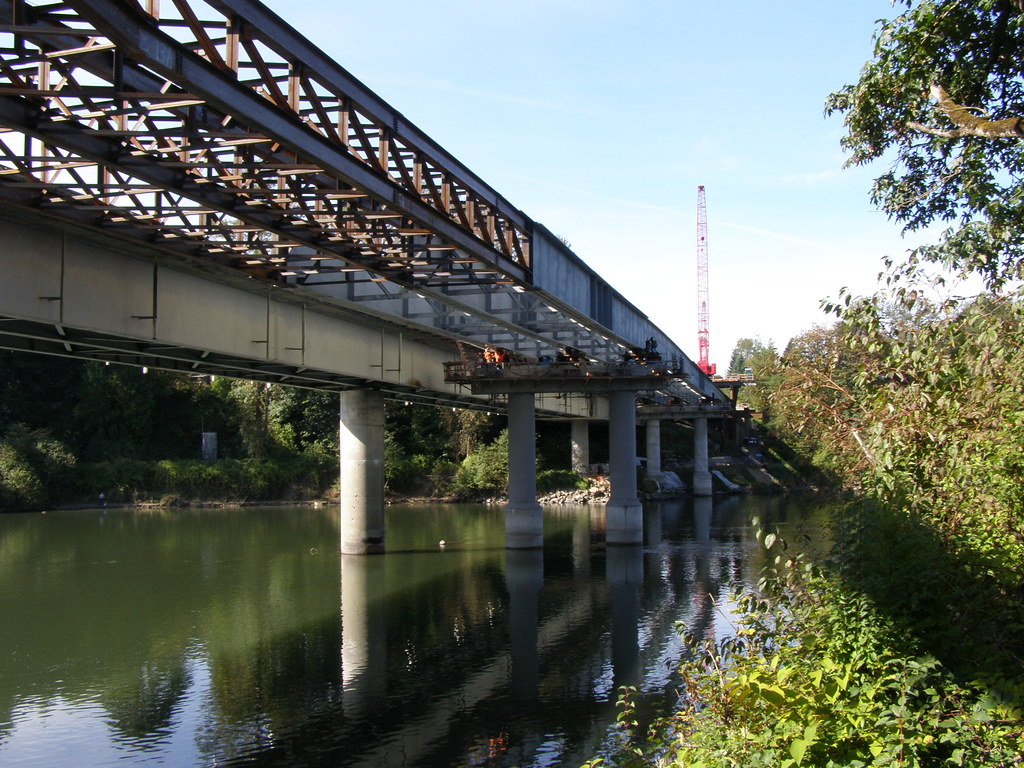 Bridge girder launching over the Snohomish River | Placing t