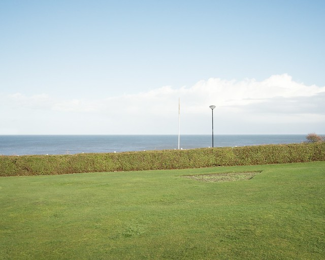 lawn, hedge, sky and sea. And lamp.