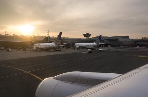 newark newjersey usa unitedstatesofamerica us america airplane plane aircraft aviation airline airliner nikond7100 nikon d7100 bensenior united unitedairlines ewr kewr boeing 737 73g 737700 b737 b73g b737700 757 752 757200 b757 b752 b757200 windowseat sun sunrise orange yellow cloudy clouds overcast terminal terminalc controltower airport apron tarmac gate jet narrowbody rb211 cfm56 rollsroyce engine jetengine sky taxi taxiing trip vacation
