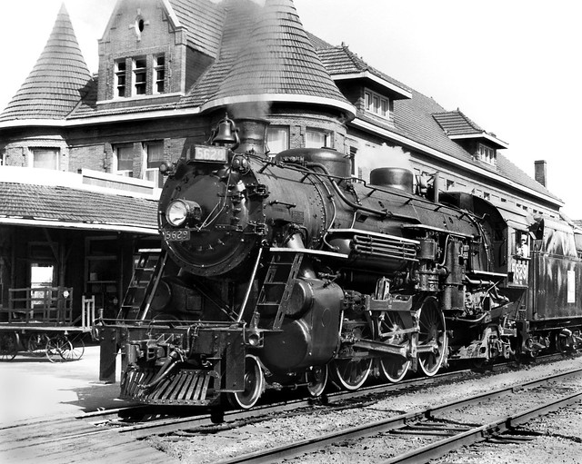 Grand Trunk Western ALCO 4-6-2 Pacific class K-4-a steam locomotive # 5629, with a railfan excursion train is seen at the station in Durand, Michigan, Circa 1960's, Unknown Photographer, Charles Snyder Collection - 2