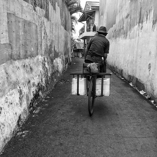 Cycling the small alleys in Kemang #jakarta #blackandwhite #monochrome #bnw #streetphotography #streetphoto #streetactivity | by Arnaldo Pellini Photographs