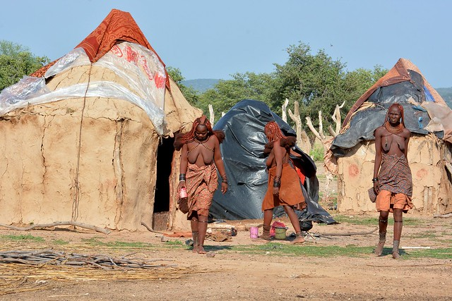 Himba woman going about their daily chores - Kaokoland region, Namibia.