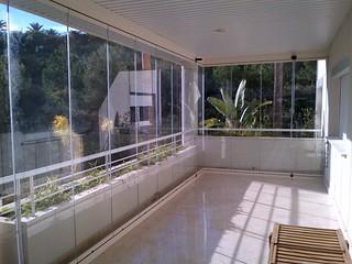 Teraszbeépítés üvegfüggönnyel