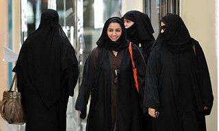 Saudi women walk inside the Faysalia shopping centre in Riyadh   by Tribes of the World
