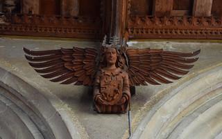 angel with the symbol of St John (Henry Ringham, 1860s)
