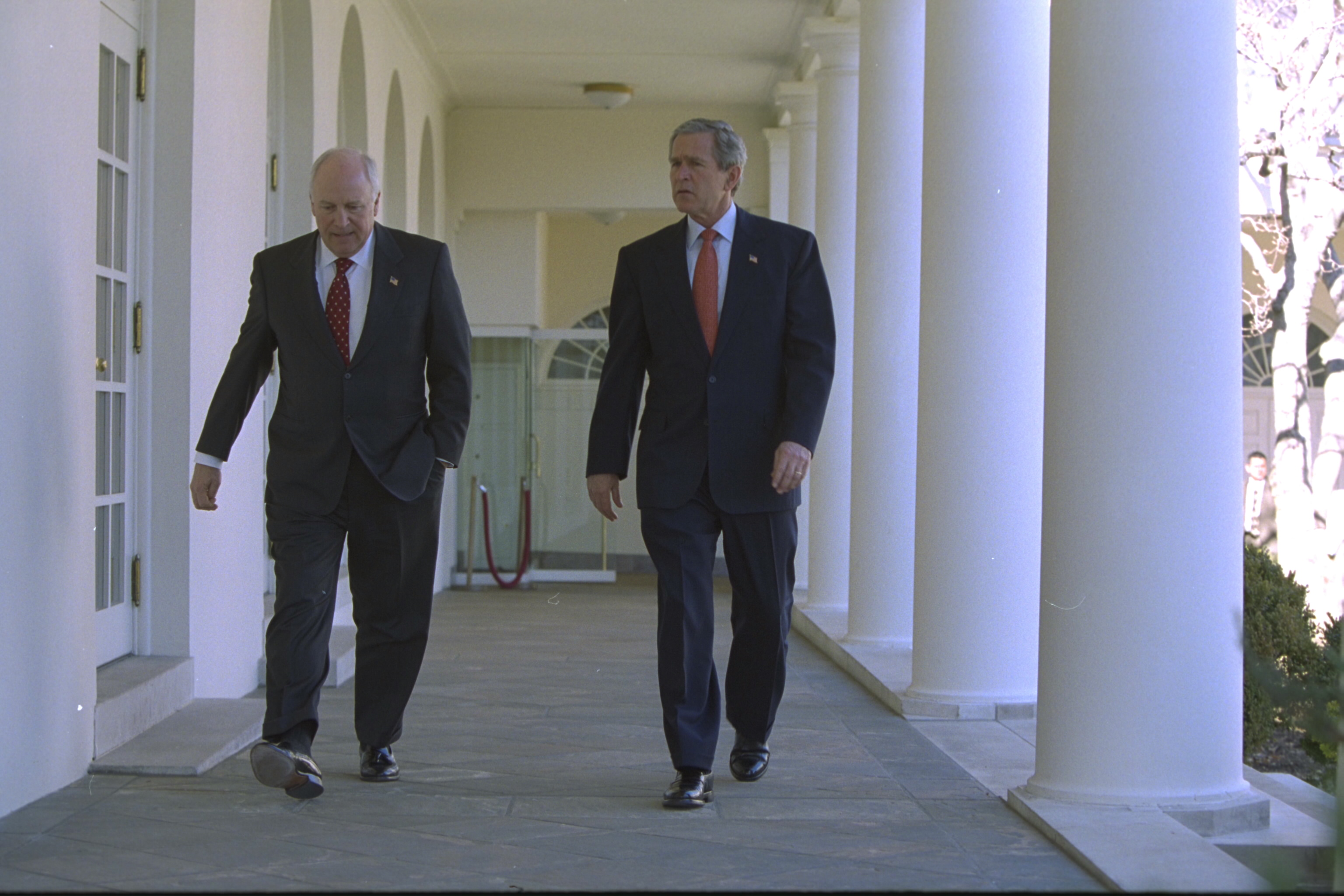 President Bush and Vice President Cheney Walk Along the White House Colonnade