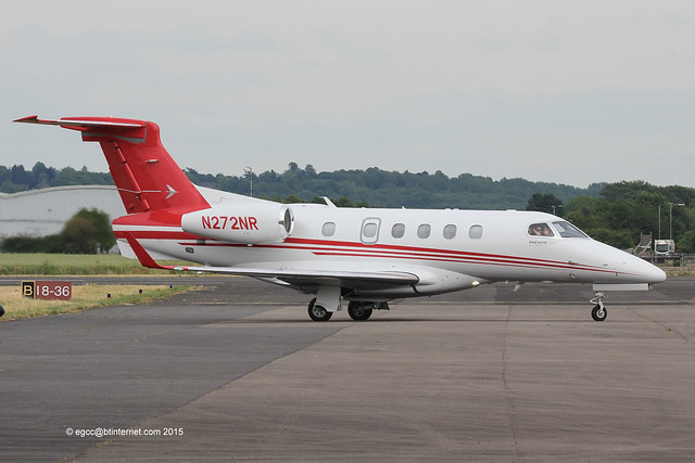N272NR - 2014 build Embraer 505 Phenom 300, taxiing for departure at Wellesbourne with a friendly wave