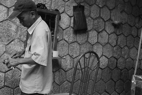 curb-side barber   by nubianomad