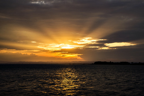 sunset sea sky water sunshine day cloudy sunsetsandsunrisesgold cloudsstormssunsetssunrises