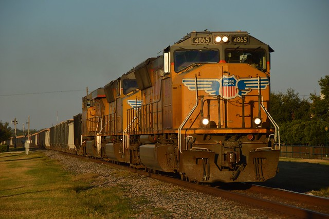 Basking in the morning glow, Union Pacific 4865 has a rock train , Hondo Texas