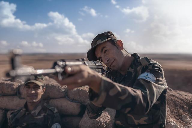An NPU christian militia new recruit aiming with his Ak 47