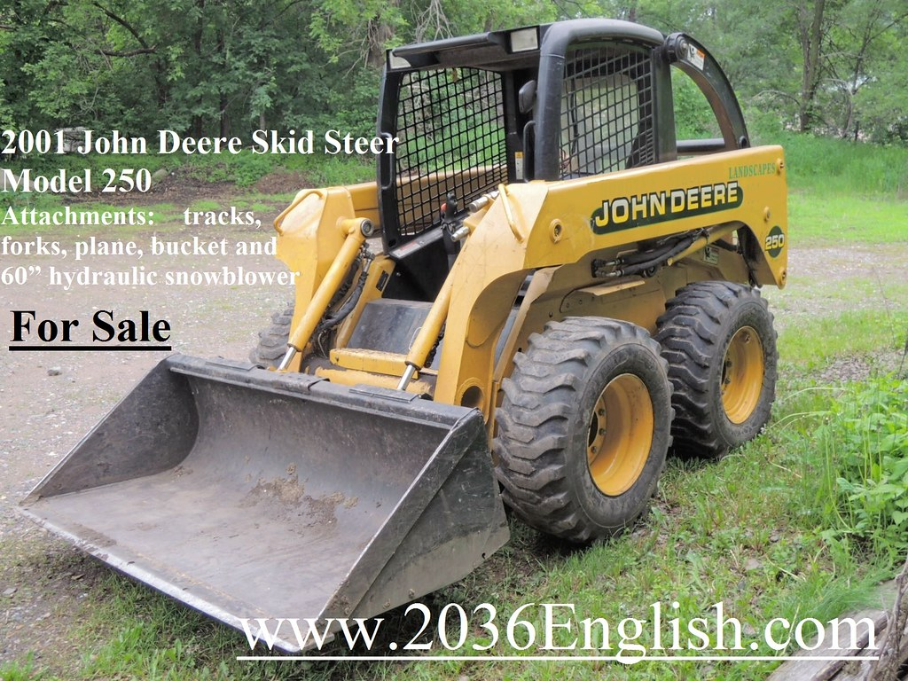 2001 John Deere Skid Steer Model 250 Attachments tracks, f