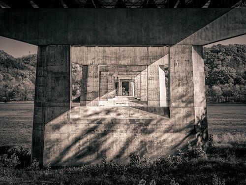 road bridge bw stone wisconsin river dark underpass concrete unitedstates steel cement overpass gritty iowa structure mississippiriver dubuque hdr m43 hwy151 microfourthirds