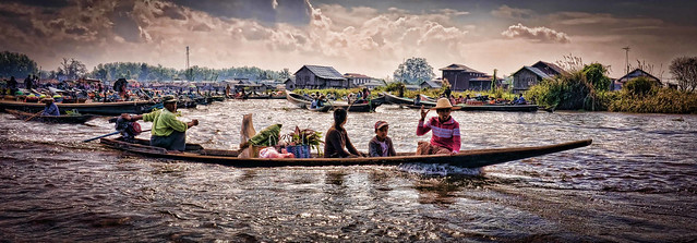 My favourite photo of the longboats at the floating market on Inle Lake.....full of atmosphere. Again Topaz Labs rescued an under exposed photo with little colour and turned it into something really special.