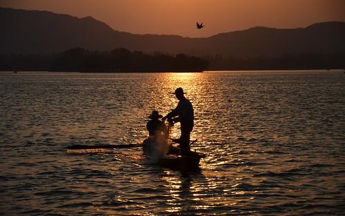 china westlake hangzhou zhejiang sunset fishermen lake unesco