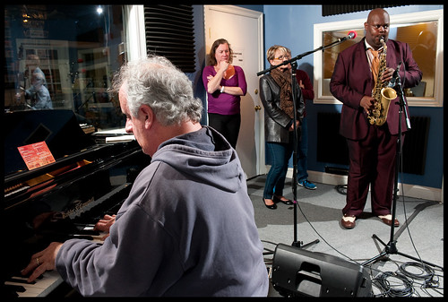 Chuck Chaplin on piano and Wess Warmdaddy Anderson on sax, while Suzanne Corley and Hayley James watch. Photo by Ryan Hodgson-Rigsbee www.rhrphoto.com