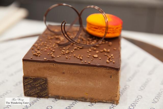 Large size Earl grey mousse chocoalte cake topped with blood orange macaron