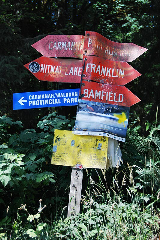 Signpost at Nitinat Junction near Bamfield, West Coast Vancouver Island, British Columbia