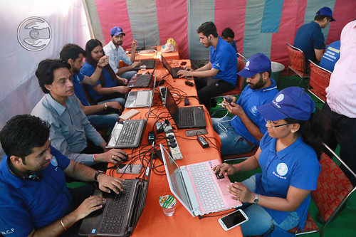 Volunteers uploading the proceedings of Blood Donation Camp in over Social Media