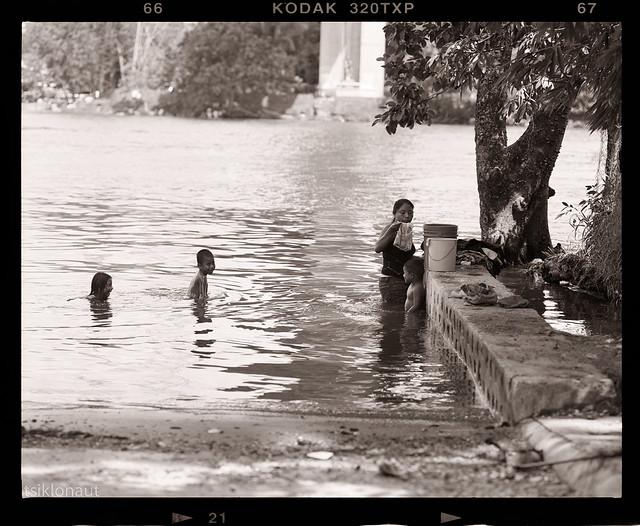 Family washday in river