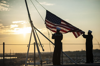 Sailors raise the ensign. | by Official U.S. Navy Imagery