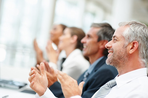Group of happy business people clapping their hands | by tec_estromberg