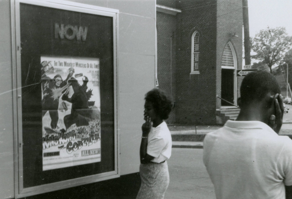 Student protesters near movie poster, State Theater, Farmville, Va., August 1963