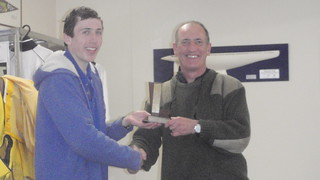 Andrew Coffin receiving from Will Perry the Club Champs Junior Trophy | by PLSC (Panmure Lagoon Sailing Club)